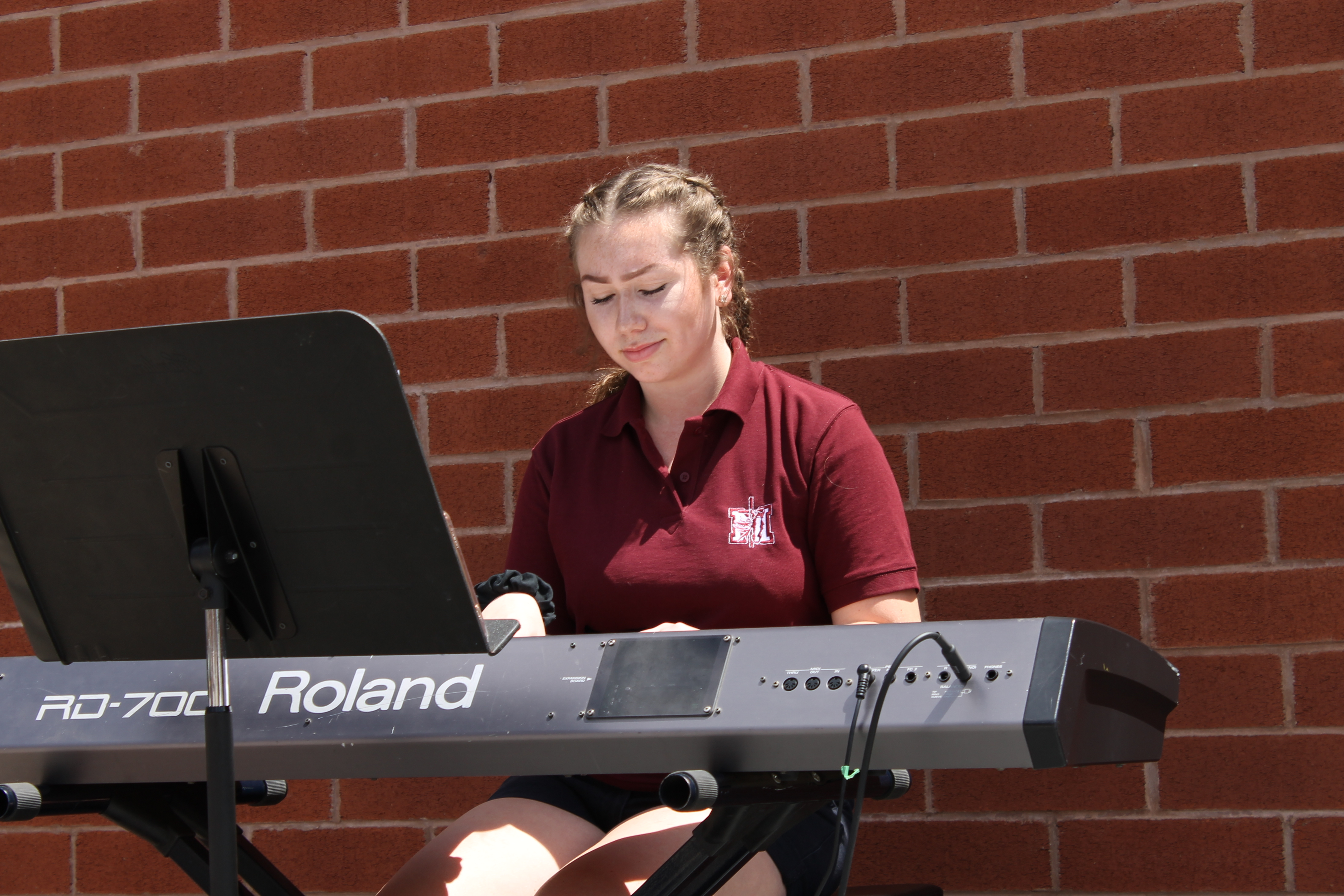 Student playing electronic instrument