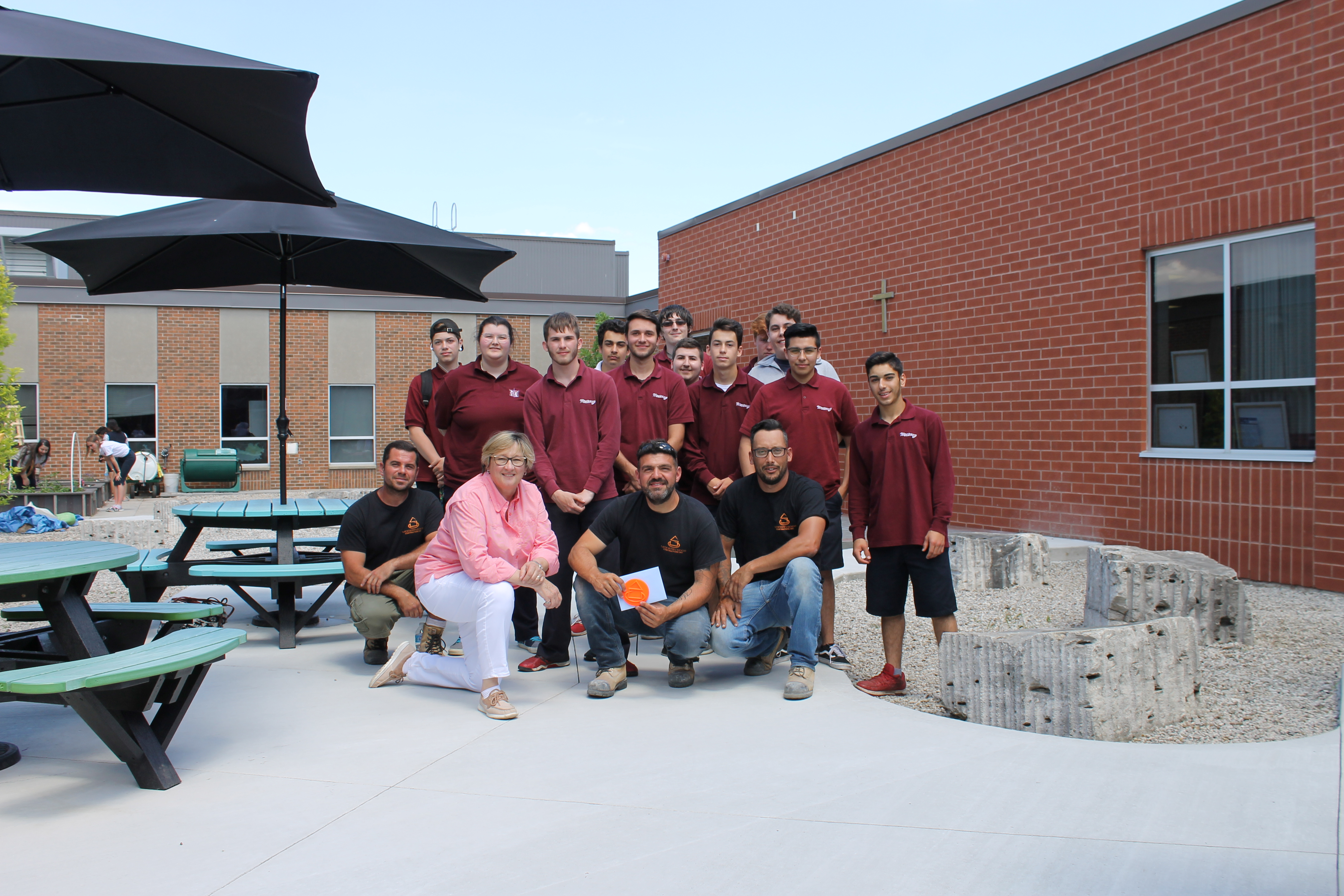 Ms. McNab's Greening class and members of the Modern Edge Contractor team.